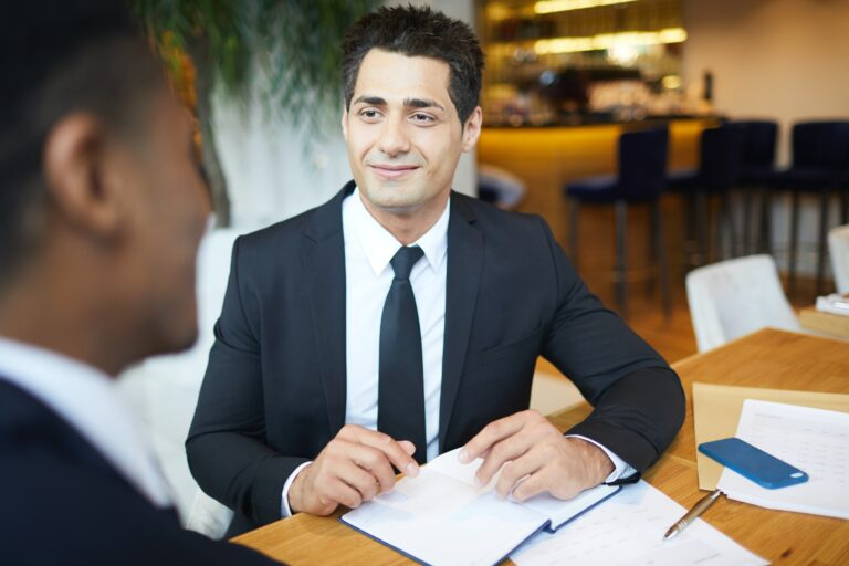 Content handsome lawyer meeting with client