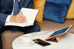 Entrepreneur writing in journal