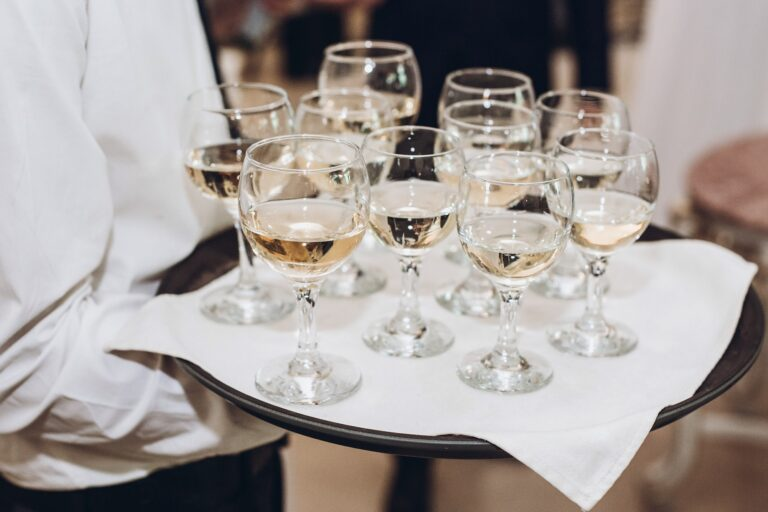 glasses of champagne or wine on tray