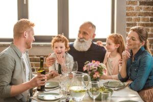 happy family having conversation during family dinner at home