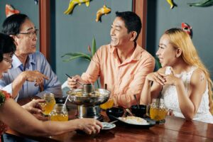 Parents and adult children having dinner
