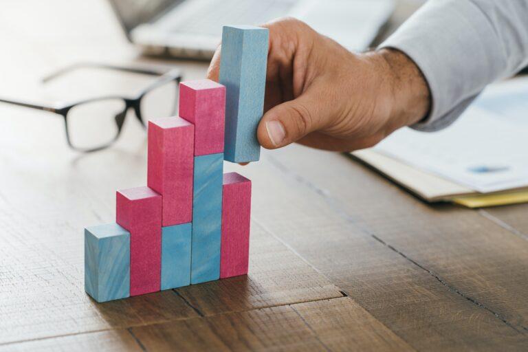 Businessman building a successful financial graph