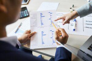 Entrepreneurs analyzing results of survey