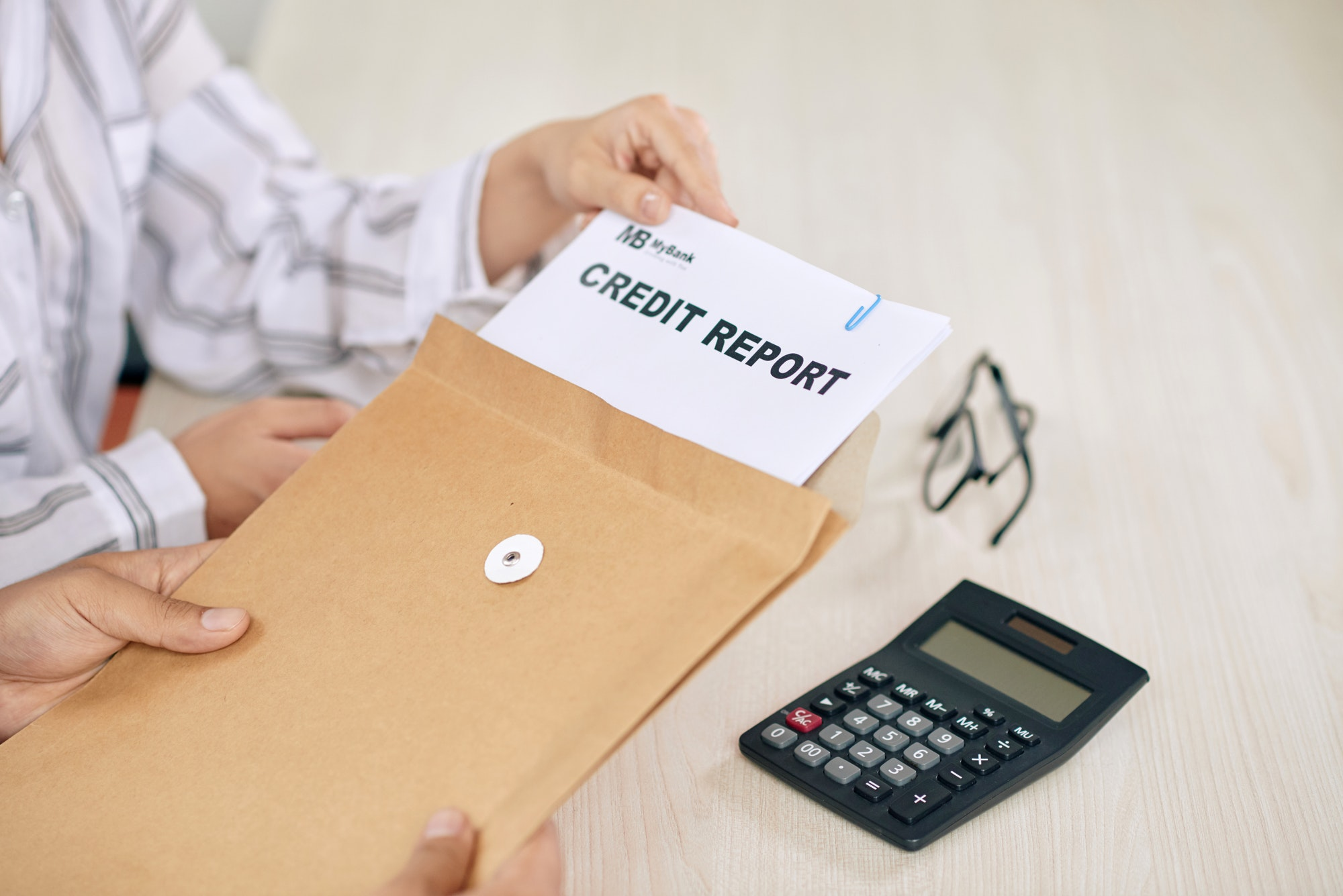 Woman showing credit report papers to client