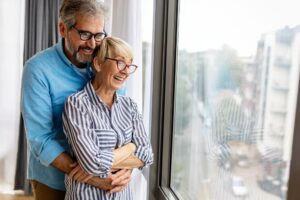 Cheerful senior couple enjoying life together, having fun at home
