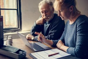 Elderly couple researching information online