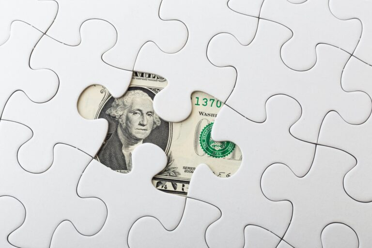 US dollar banknote and puzzle