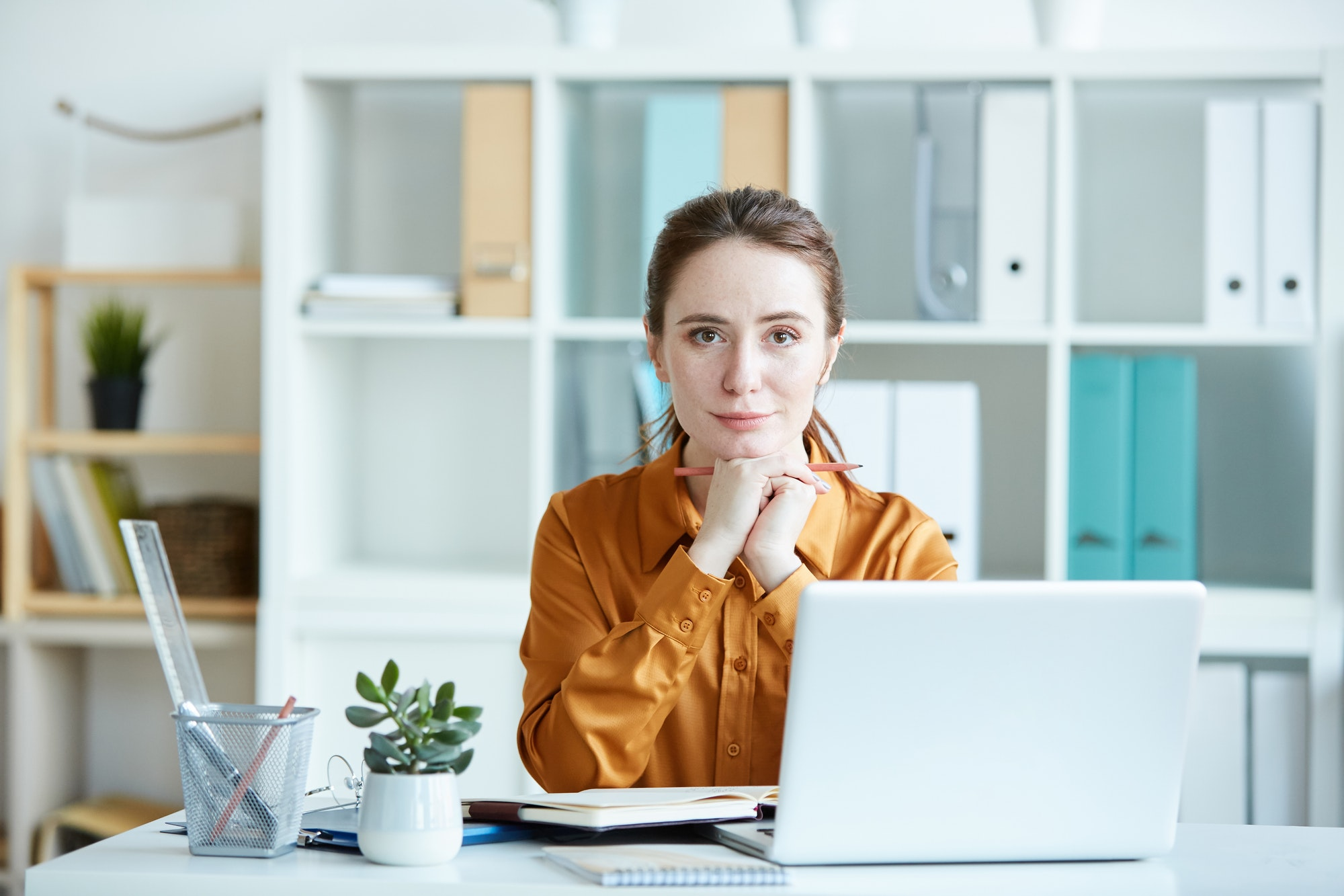 Female leader working at office