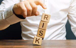 Man removes blocks with the word Risk